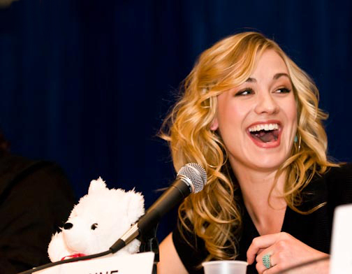 Yvonne is delighted at a press conference.