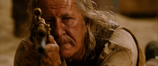 Geoffrey Rush lowers himself both figuratively and literally.
